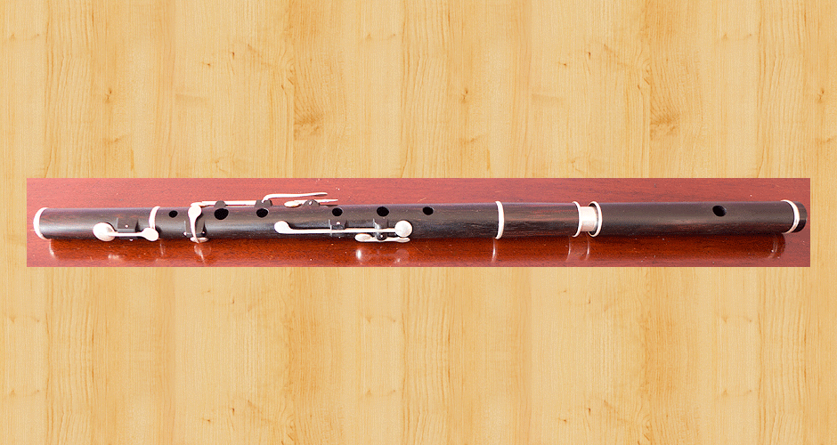 A Martin Doyle left handed six key flute made from Brazilian Rosewood.