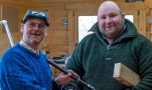 Martin Doyle presents a keyed flute to his friend and part-time assistant Brian Morgan, who is a local flute player.