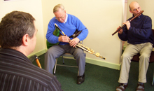 Martin Doyle playing an Irish traditional tune with pipers Ronan Browne and Seán McKiernan.