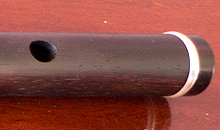 A Martin Doyle left handed six key flute made from Rosewood.