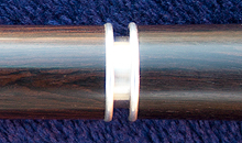 A thin-walled sterling silver tuning slide set in a Martin Doyle traditional style keyless flute made of African Blackwood.