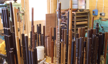A wide variety of flutes and flute parts stand, like soldiers at attention, in Martin Doyle's workshop.